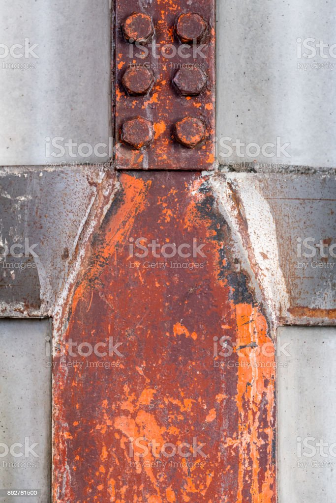 Steel construction beams indoors in the shape of a human with lego like head. royalty-free stock photo