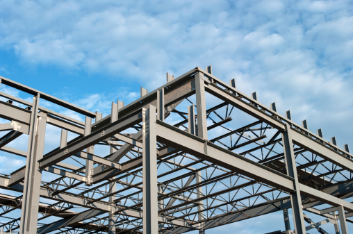 The steel frame of a new office building under construction.Similar Images.