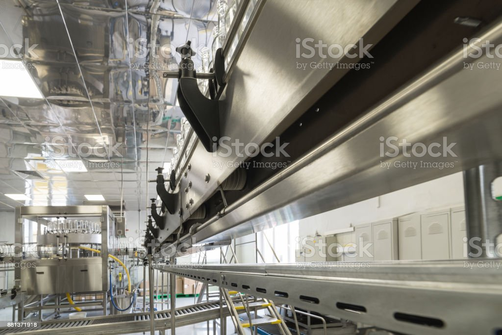 Steel conveyor for transportation of glass bottles stock photo