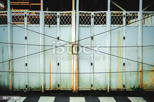 Steel door closing with electric cable in constraction site