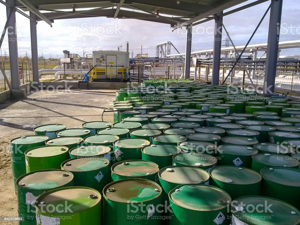 Steel drums with chemical reagent. Canopy for storage of chemical agent. stock photo