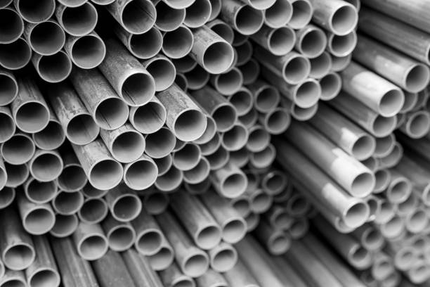 steel electric conduit pipes stack of steel electric conduit pipes, black and white tone, selective focus, industry concept background canal stock pictures, royalty-free photos & images