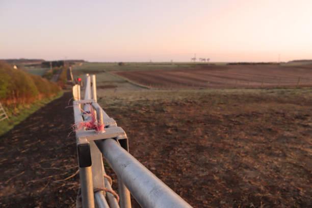 Steel farm gate stock photo
