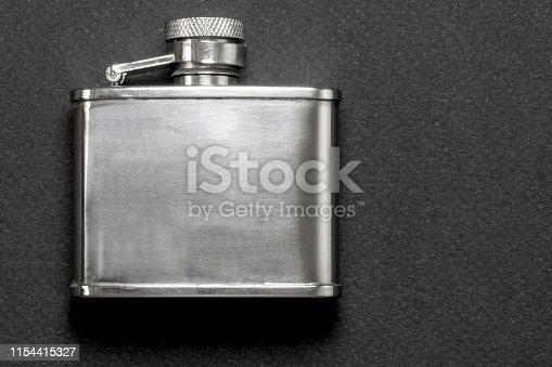 flasks for drinks on black background