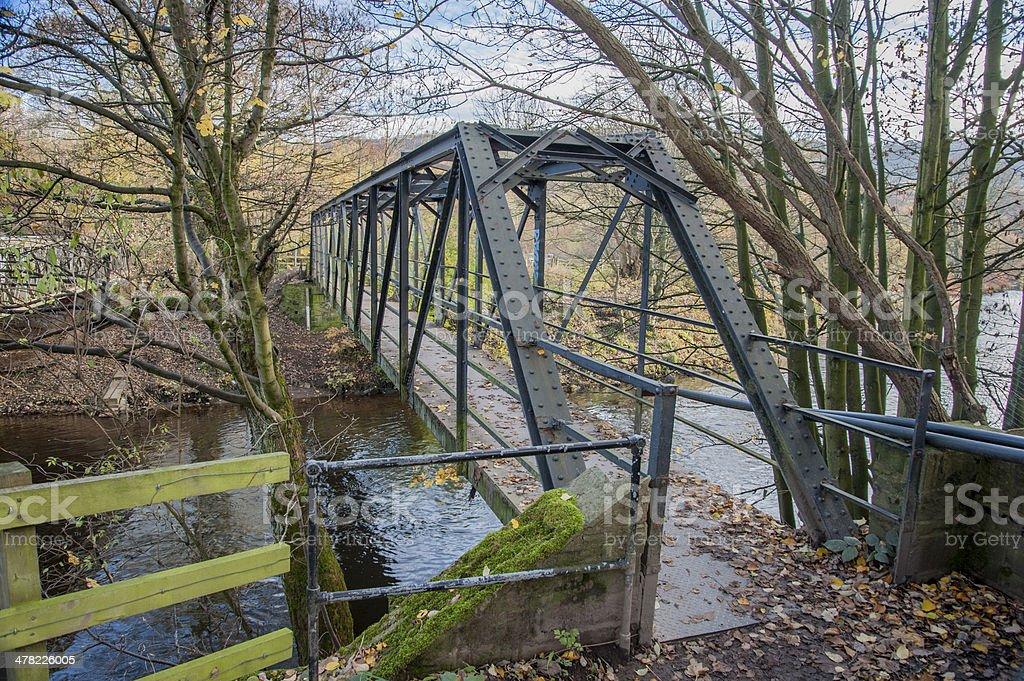 steel footbridge over a river stock photo