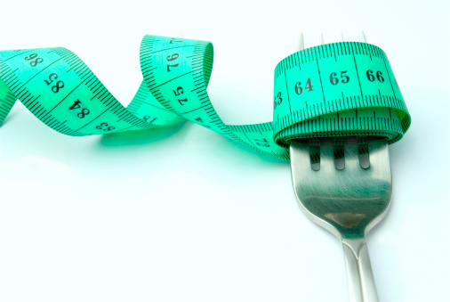 istock steel fork and measuring tape on white background 126051367