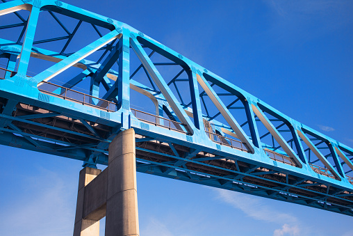 View from below of a steel frame bridge in Newcastle, Northumberland, England.