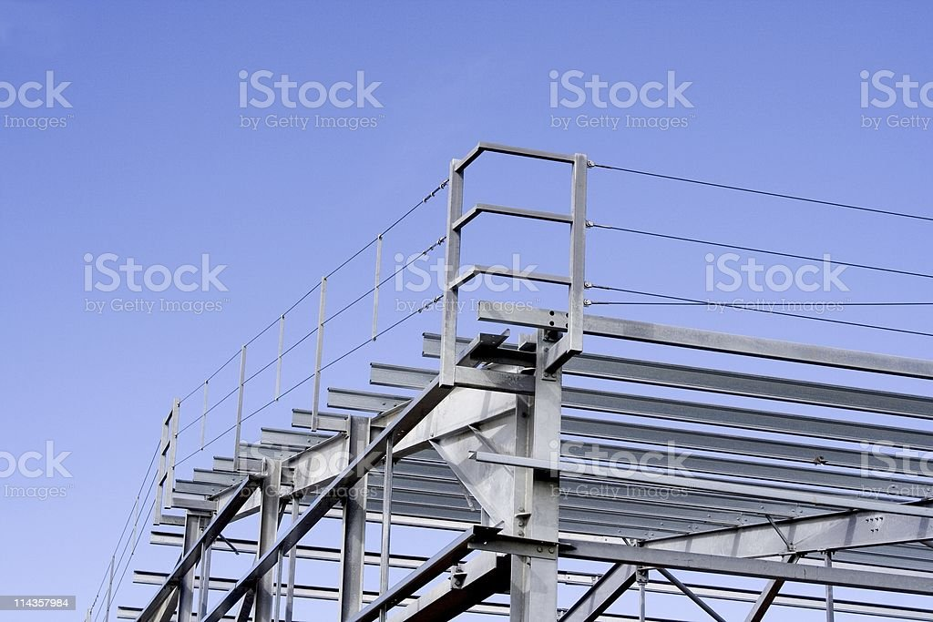 Steel Frame Of New Factory Construction Against Blue Sky stock photo