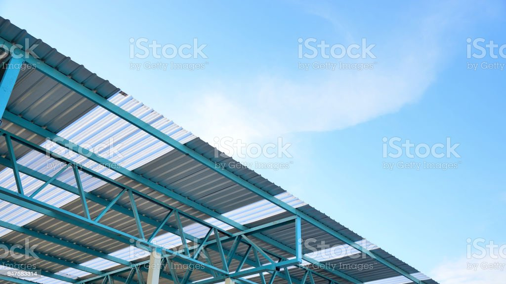 Steel frame structure of metal sheet roof. stock photo