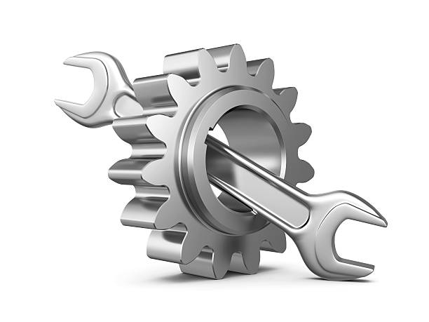 steel gear and wrench tool stock photo