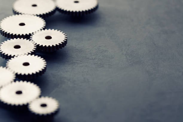 steel gears background - cog stock photos and pictures