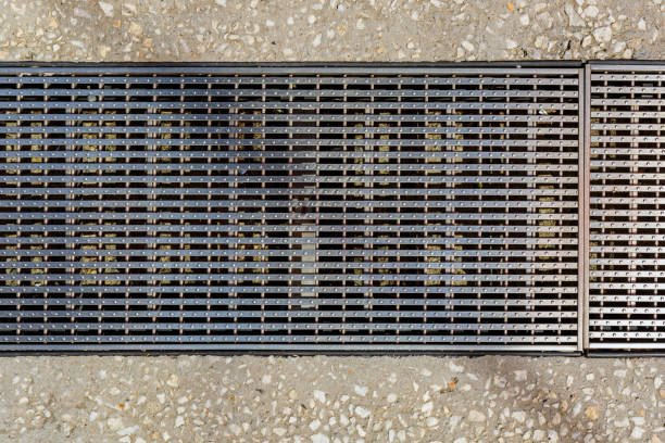Steel Grate On Concrete Footpath stock photo