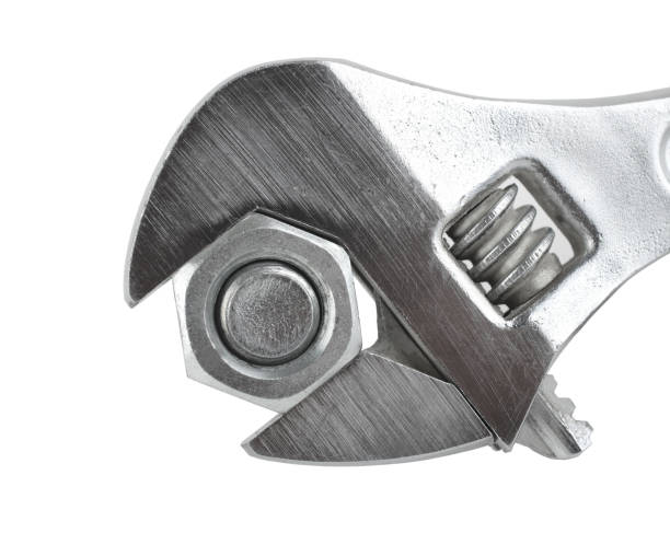 Steel gray adjustable spanner clasping a bolt Steel gray adjustable spanner clasping a bolt washer fastener stock pictures, royalty-free photos & images