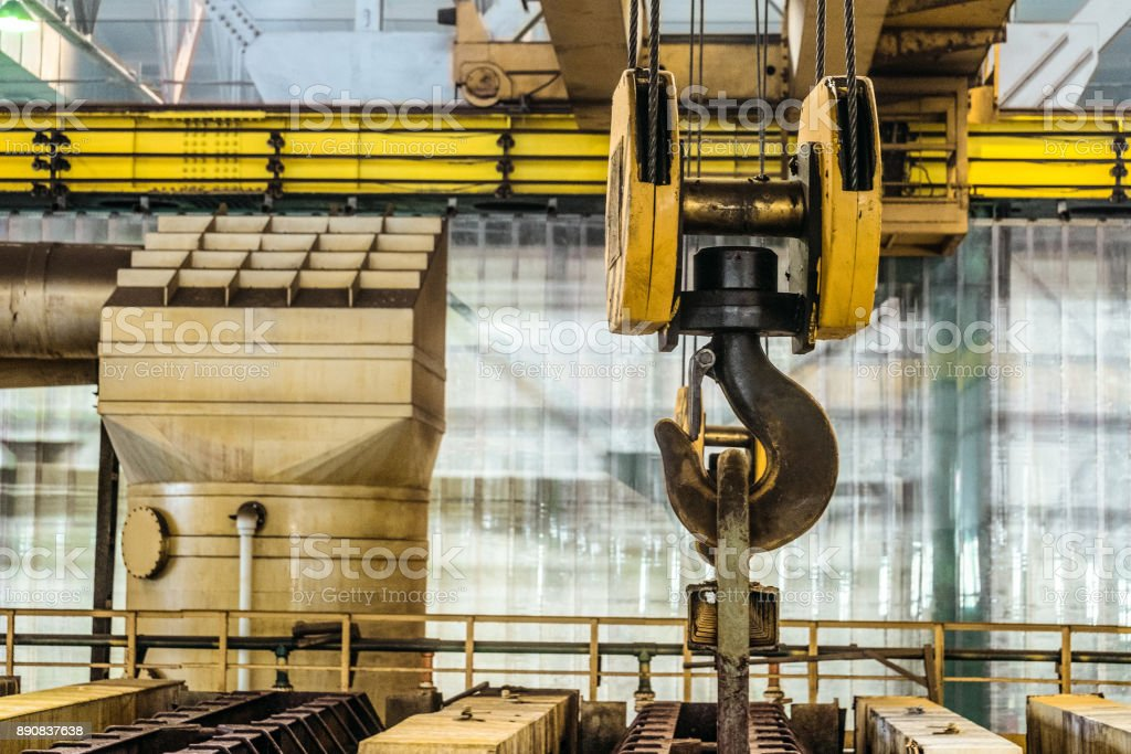Steel hook of overhead crane over industrial equipment stock photo