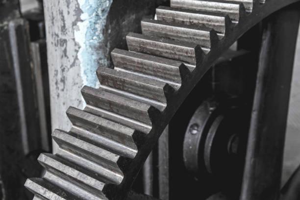 Steel huge gear. Flywheel from an old machine in a factory. – zdjęcie