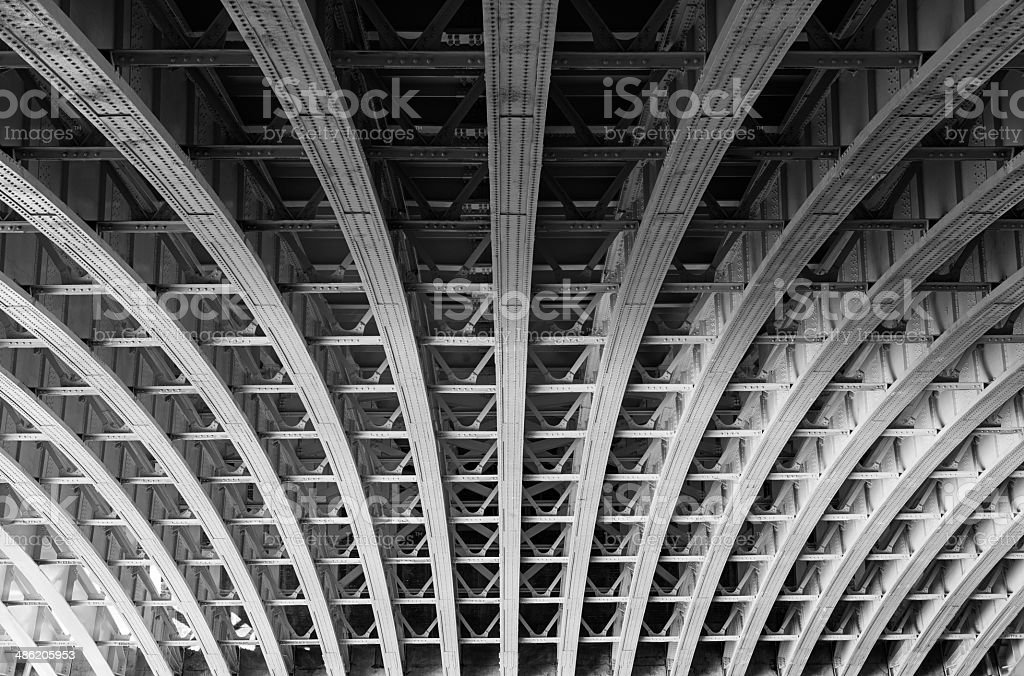 Steel lines under a bridge in London stock photo