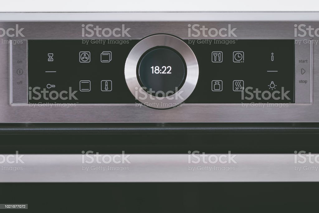 Steel modern touching panel of house electric oven. stock photo