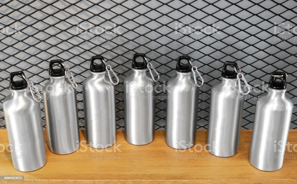 Steel mug on white shelf. Blank stainless tumbler for your design. Insulated bottle for keep your drink. stock photo