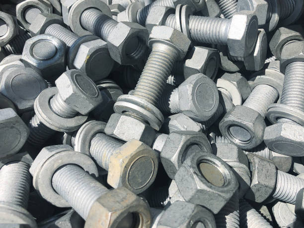 Steel nuts and screws piled in the box. Fastening construction equipment. Fixing hardware Steel nuts and screws piled in the box. Fastening construction equipment. Fixing hardware washer fastener stock pictures, royalty-free photos & images