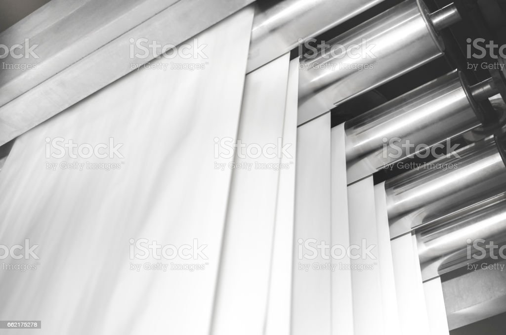 Steel Offset Printing Cylinders and layers of roll paper for magazine productin stock photo