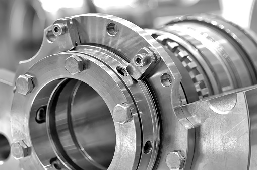 Steel parts for industrial machinery round shape. Black and white toning. Close up.