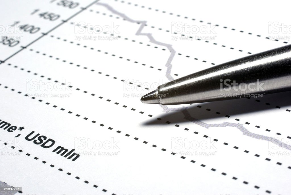 Steel pen macro on financial report. royalty-free stock photo