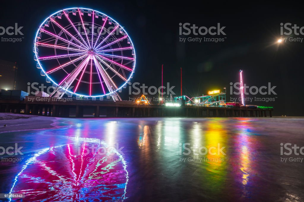 steel pier with reflection at night,Atlantic city,new jersey,usa. stock photo
