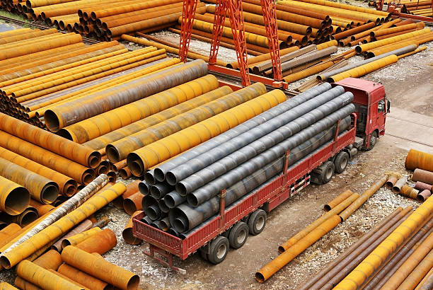 steel pipe with truck stock photo