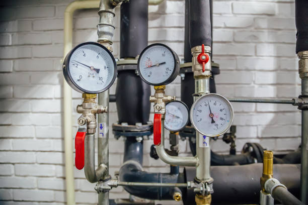 Steel pipeline of heating system with manometers stock photo