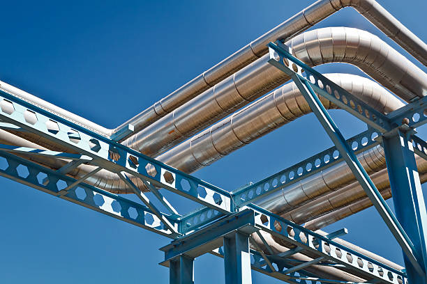 steel pipelines from the power station - cogeneration plant stock photos and pictures