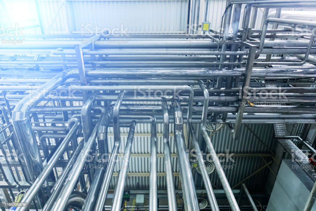 Steel Pipes Of Industrial Machinery Equipment At Chemical Or Food Factory  Stock Photo - Download Image Now - iStock