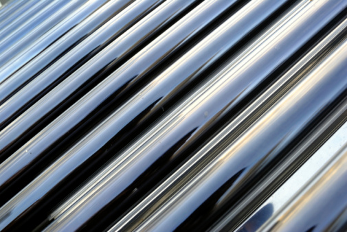Photo of cold blue steel pipes.