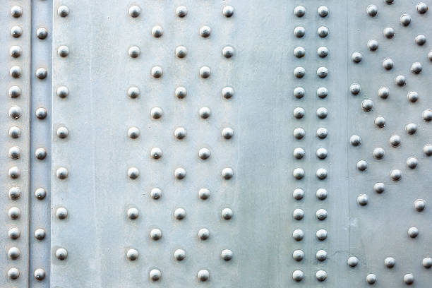 Steel plate background, closeup bridge steel beam with bolts Steel plate background, closeup Harbour Bridge large steel beam with bolts, abstract background, full frame horizontal composition with copy space girder stock pictures, royalty-free photos & images