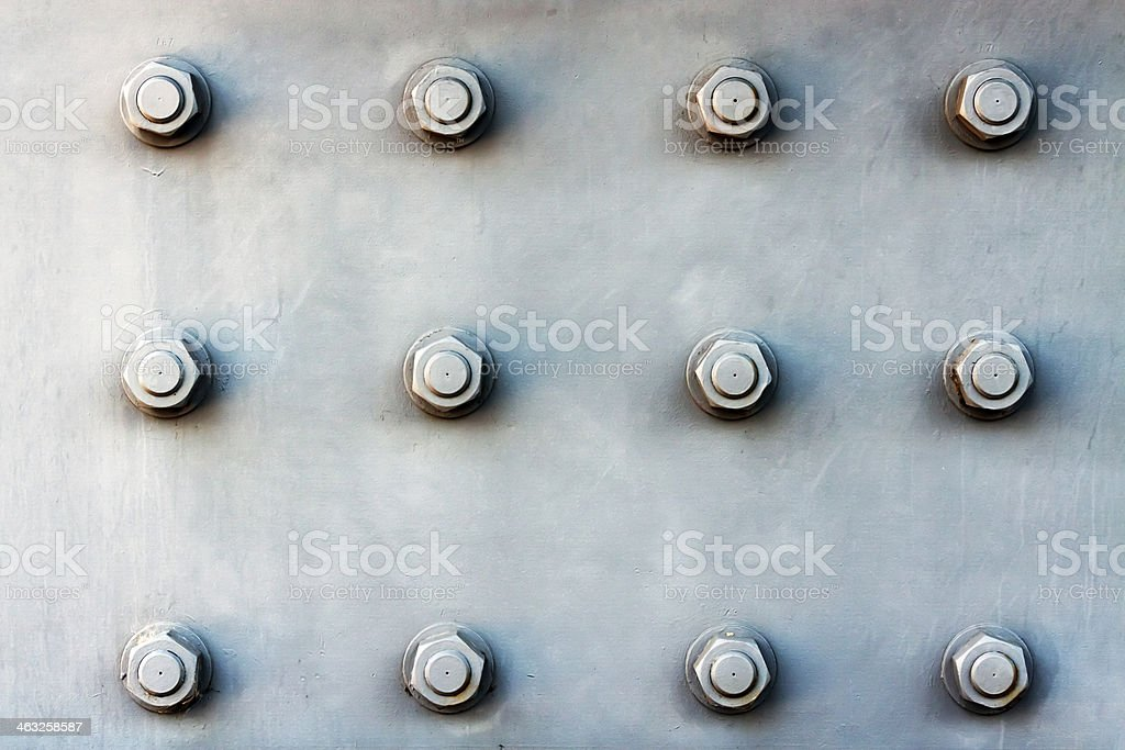 Steel plate  background with large bolts stock photo