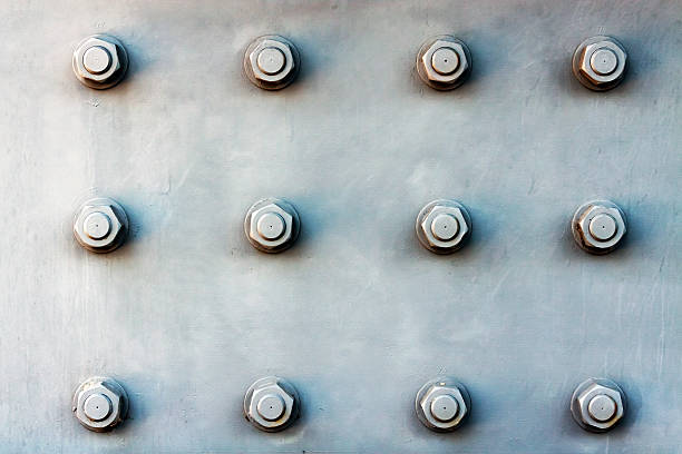 steel plate  background with large bolts - bolt stock photos and pictures