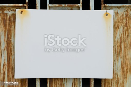 924754302istockphoto Steel plate painted white background Hung on an old iron frame Rusty. for empty and copy space background. 1175420474