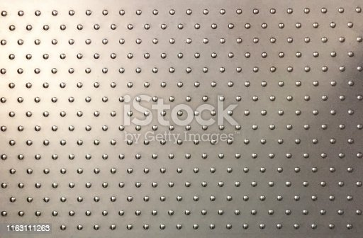 istock Steel plate with anti slip buttons 1163111263