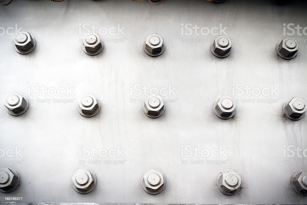 Steel plate with bolts and nuts, vignette stock photo