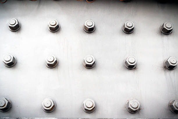 steel plate with bolts and nuts, vignette - bolt stock photos and pictures