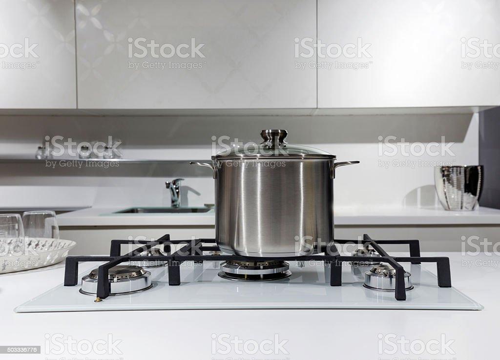 steel pot on gas stove in modern kitchen stock photo