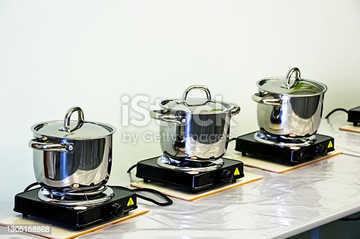 istock Steel pots on electric stoves. Cooking 1305158868