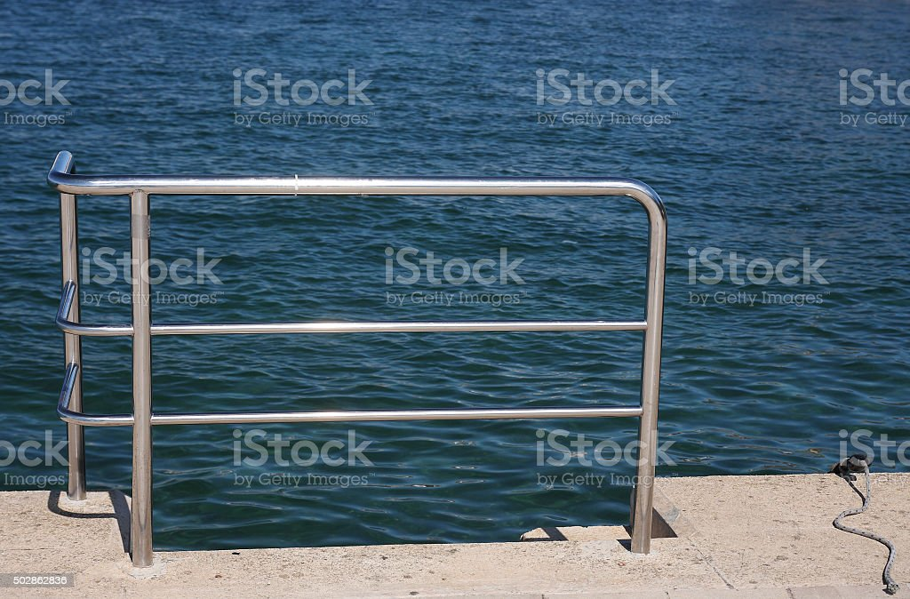 Steel railings un tuorist harbor in the summer day. stock photo