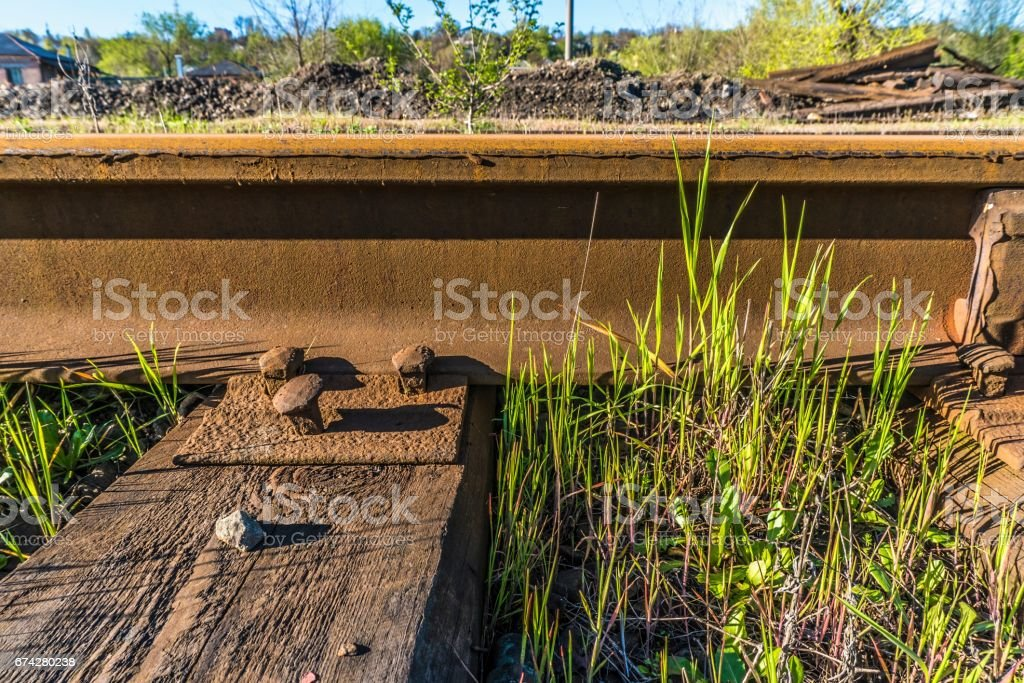 Steel Rails Bolted Down To Wooden Railroad Ties Stock Photo