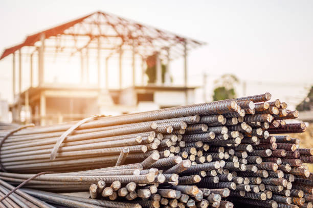 steel rebar for reinforcement concrete at construction site with house under construction background steel rebar for reinforcement concrete at construction site with house under construction background rod stock pictures, royalty-free photos & images
