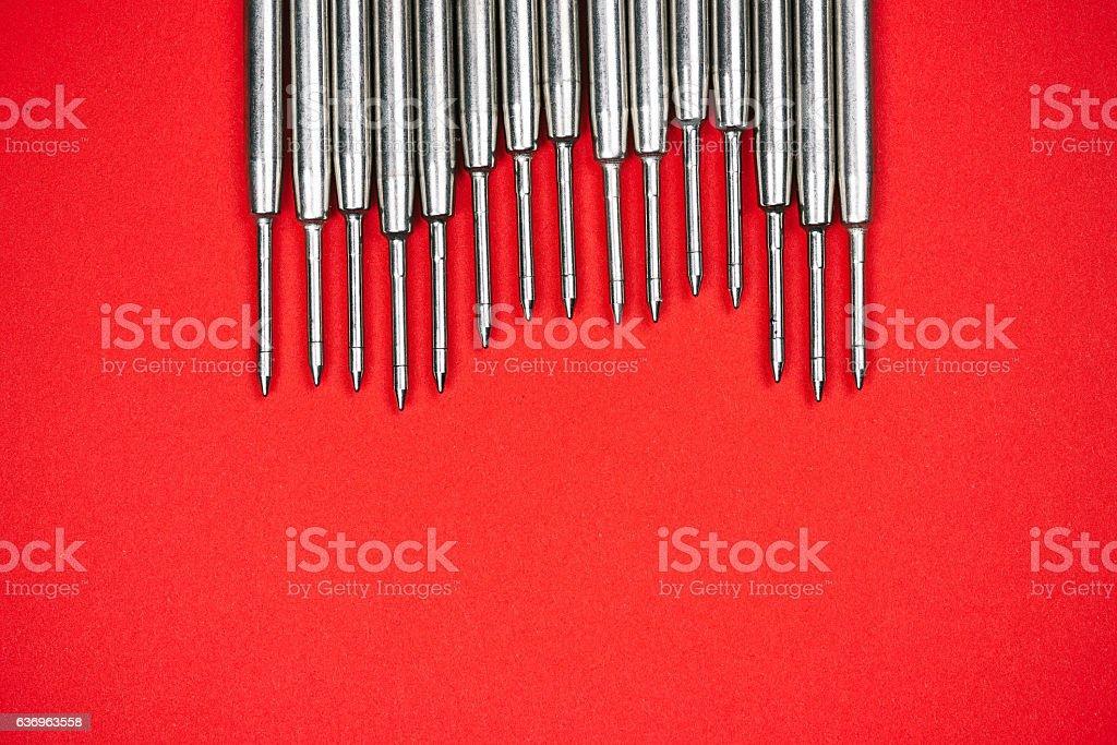 Steel refills on red stock photo