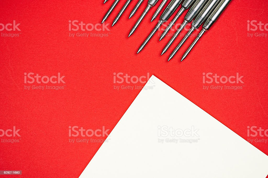 Steel refills over red stock photo