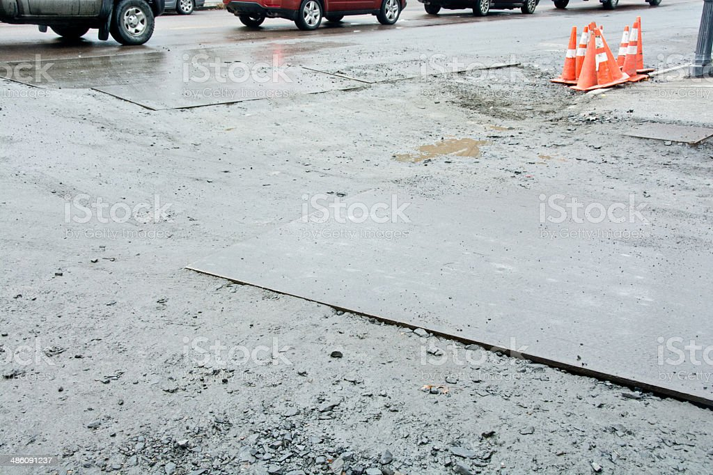 Steel road plate with traffic cones stock photo