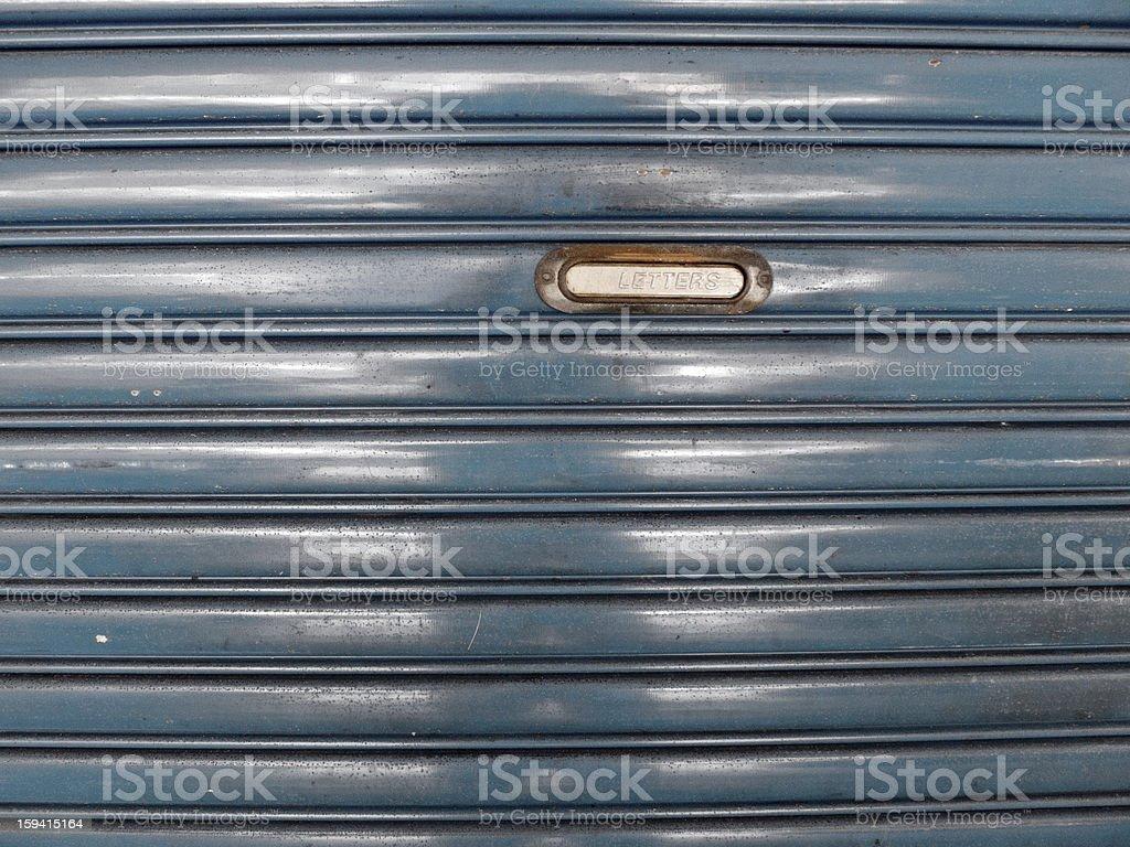 steel roll up door with mailbox stock photo