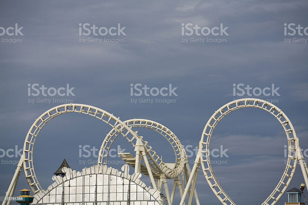 Steel roller coaster against a dark sky. royalty-free stock photo