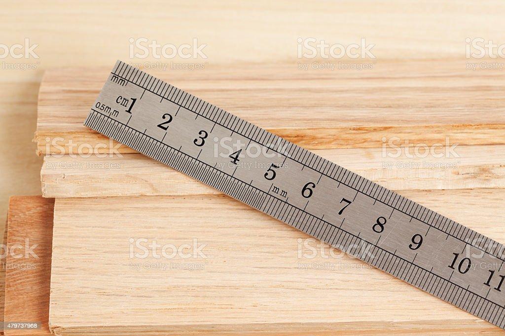 Steel Ruler to Measure Wood Planks stock photo